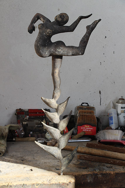 bronze casting of dancing figure